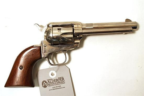 "Colt Frontier Scout single action revolver. Cal. 22 LR. 5"" bbl. SN 8205K. Nickel finish on metal, barrel appears to have marks scrap..."