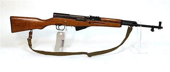 "Norinco Type 56 SKS semi-automatic rifle. Cal. 7.62 x 39 mm. 20"" bbl. SN 2216582. Blued finish on metal, canvas sling, walnut stock ..."