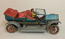German Tin Litho Limousine; wind up, not operational, missing head lamps and passenger, scratches and paint chips, good condition