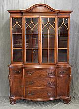 Breakfront Bookcase, Mahogany, Serpentine Front, Two Glazed Doors over Five Drawers and Two Doors, Ancanthus Carved Sides, Bracket F...
