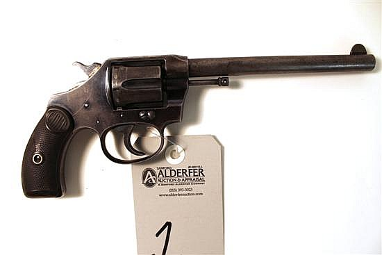 """Colt New Pocket Pocket Positive double action revolver. Cal. 32 S&W LC. 6"""" bbl. SN 38385. Patina finish on all metal with multiple a..."""