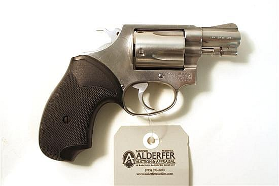 "Smith & Wesson Model 60 double action revolver. Cal. 38. 2"" bbl. SN AFF3489. Stainless steel finish on metal, after market rubber co..."