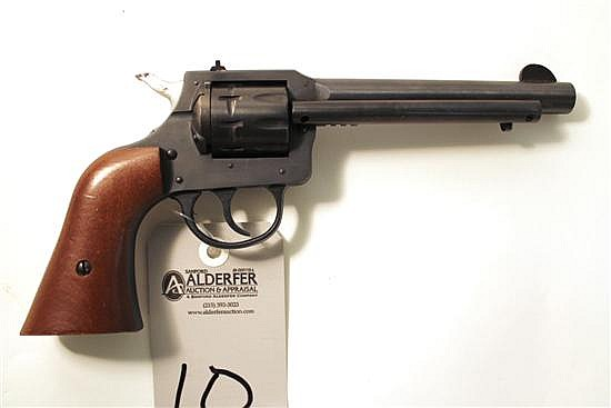 "H&R Inc. Model 949 double action revolver. Cal. 22 LR. 5-1/2"" bbl. SN BB012941. Blued finish on metal, plain walnut grips have minor..."