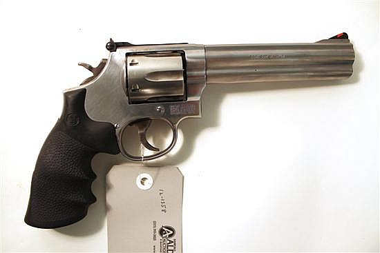 "Smith & Wesson Model 686-5 double action revolver. Cal. 357 Mag. 6"" bbl. SN CDJ2817. Stainless steel finish on metal, factory rubber..."