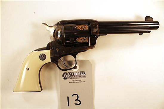 "Ruger Vaquero single action revolver. Cal. 45. 5-1/2"" bbl. SN 56-24244. Blued finish on barrel, case colored frame, case color does..."