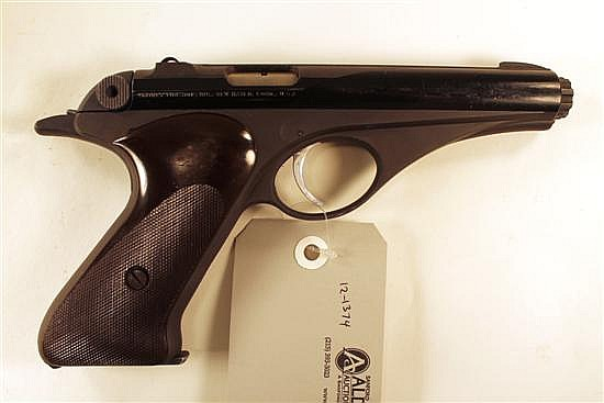 """Whitney Firearms Co. Wolverine semi-automatic pistol. Cal. 22 LR. 4-3/4"""" bbl. SN 28913. Blued finish on slide, matte frame, brown di..."""
