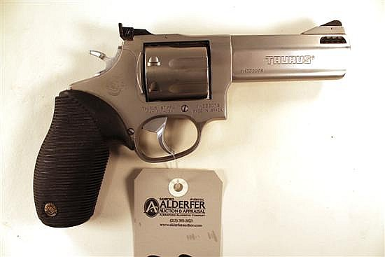 """Taurus 627 Tracker double action revolver. Cal. 357 Mag. 4"""" ported bbl. SN YH332078. Stainless steel finish no metal, rubber factory..."""