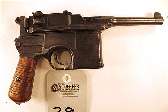 "Mauser Model 1896 Broomhandle semi-automatic pistol. Cal. 7.63 x 25 mm. 4"" bbl. SN 665445. Blued finish on metal, most of metal show..."