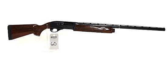 "Remington Model 1100 semi-automatic shotgun. 12 ga. 28"" vent rib bbl. 2-3/4"" chamber. Adjustable choke. SN N279934V. Blued finish on..."
