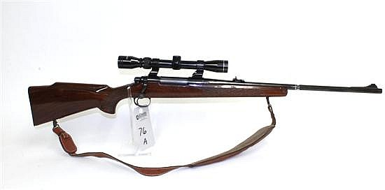 "Remington Model 700 bolt action rifle. Cal. 30-06. 23"" bbl. SN B6227584. Blued finish on metal, jeweled bolt, checkered walnut stock..."