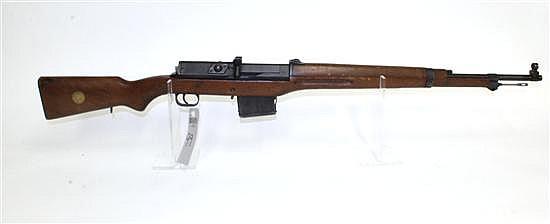 """Swedish Ljungman AG-42B semi-automatic rifle. Cal. 6.5 mm. 24-1/2"""" bbl. SN 23506B. Blued finish on metal, cleaning rod, walnut stock..."""