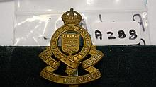 Royal Army Ordinance Corps cap badge with slider