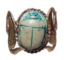 An Egyptian scarab mounted in a gold ring