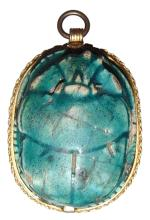 A superb Egyptian scarab set into a gold pendant