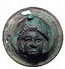 Roman bronze rondel with the head of the god Men