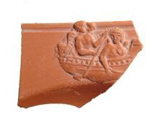 Roman terra sigillata pottery fragment depicting two winged erotes