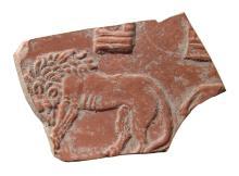 Roman terra sigillata pottery fragment depicting a lion