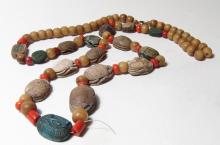 Necklace strung with Egyptian scarabs and scaraboids
