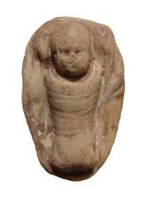 A Greek terracotta swaddled baby