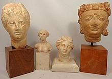 4 museum replicas of ancient female heads