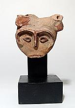 A terracotta head from a bull