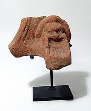 A terracotta pot-support with mask of Papposeilenos