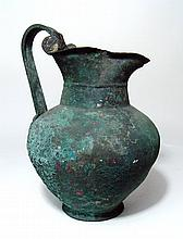 A large Greek bronze Oinochoe