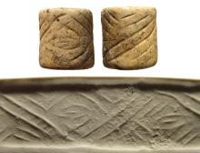 A beige marble Proto-Elamite cylinder seal