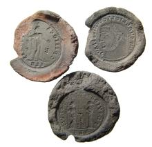 A lot of 3 ancient counterfeiter's molds