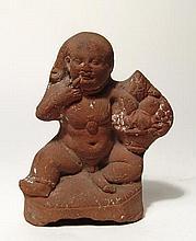 An Egyptian terracotta figure of Harpokrates