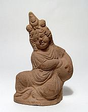 A terracotta, seated figure of Harpokrates