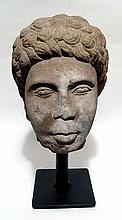 A carved head of a Nubian youth