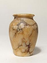 An Egyptian marble cosmetic jar