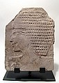 Egyptian limestone relief depicting a youth
