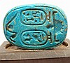 Large blue glazed scarab with cartouche on underside