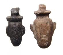 A pair of Egyptian stone heart or 'ib' amulets