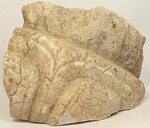 A Near Eastern limestone wall relief fragment