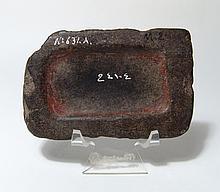 An Egyptian basalt palette for pigment