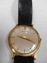 Vintage Men's Gold Movado Watch with Black Leather