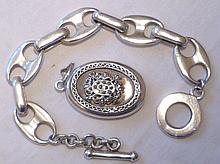 Silver hallmarked oval locket with ornate front, 3