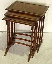 Nest of three walnut veneer side tables,
