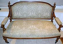 Two seater sofa with open arms and carved wooden