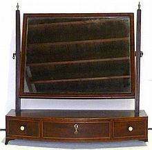 Georgian mahogany bow front dressing table swing
