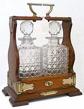 Oak tantalus decanter with two cut glass spirit