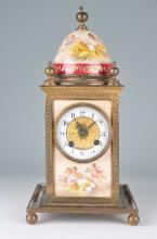 Hand painted dome mantle clock with painted panels of Chrubs and women on the fo