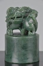 Chinese spinach-green jade carving of a Lotus tree and a village hut