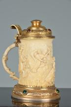 Gold gilt and jeweled ivory handled stein.