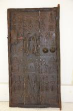 19 th century African craved grain door.<BR>25 inches x 51 inches.