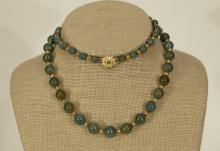 A Green Jadeite Necklace w/ Gold