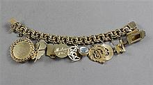 STAMPED 14K YELLOW GOLD CHARM BRACELET WITH 13 GOLD FILLED TO 14K CHARMS, 6 3/4